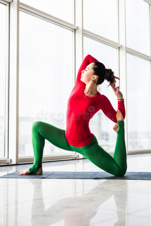 Beautiful yoga woman practice in a big window hall background. Yoga concept royalty free stock photos