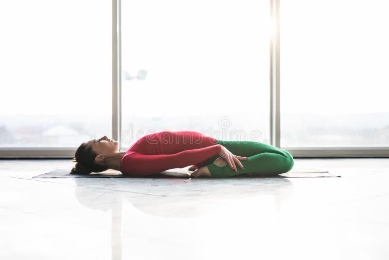 Beautiful yoga woman practice in a big window hall. Background. Yoga concept stock image