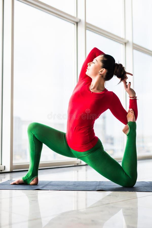 Beautiful yoga woman practice in a big window hall background. Yoga concept stock image