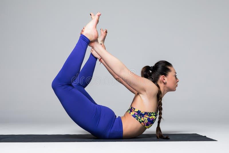 Beautiful yoga woman practice yoga poses on grey background. Yoga concept stock image