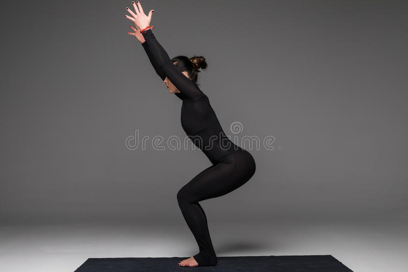 Beautiful yoga woman practice yoga poses on grey background. royalty free stock image
