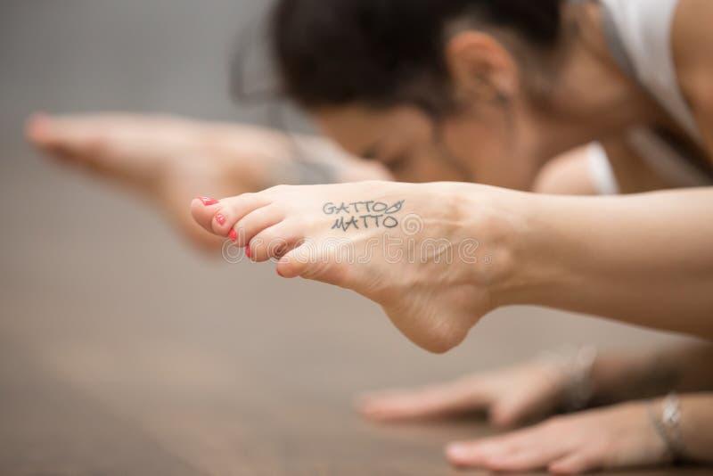 Beautiful Yogi woman with tattoo on her leg royalty free stock photo