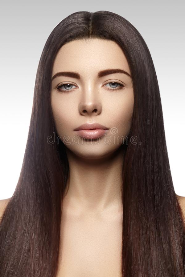 Beautiful yong woman with long straight brown hair. fashion model with smooth gloss hairstyle royalty free stock photos