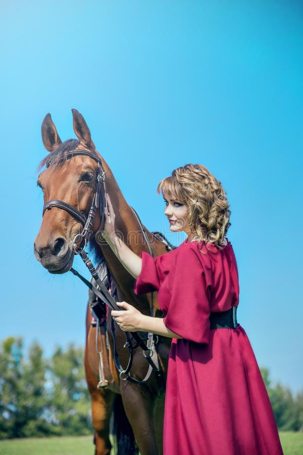 Beautiful yong womanl and horse stock photos