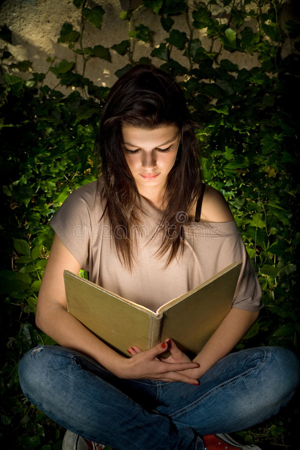 Download Beautiful Yopung Brunette Immersed In Readin Stock Image - Image: 20419025