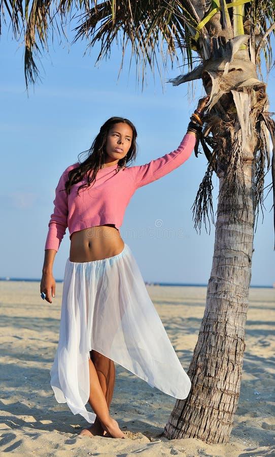 Beautiful youn biracial woman on beach royalty free stock photo