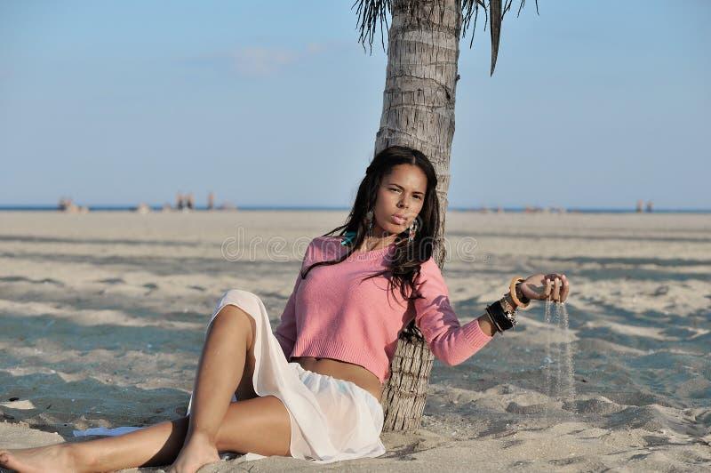 Beautiful youn biracial woman on beach stock photo