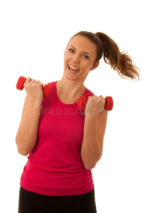 Beautiful young active fit woman workout with dumbbells isolated over white background - fitness royalty free stock images
