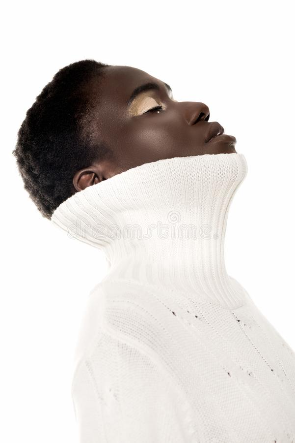 beautiful young african american woman with closed eyes wearing white sweater royalty free stock image