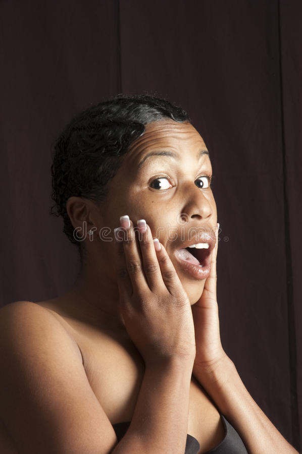Beautiful Young African American Woman Surprised Stock Photo