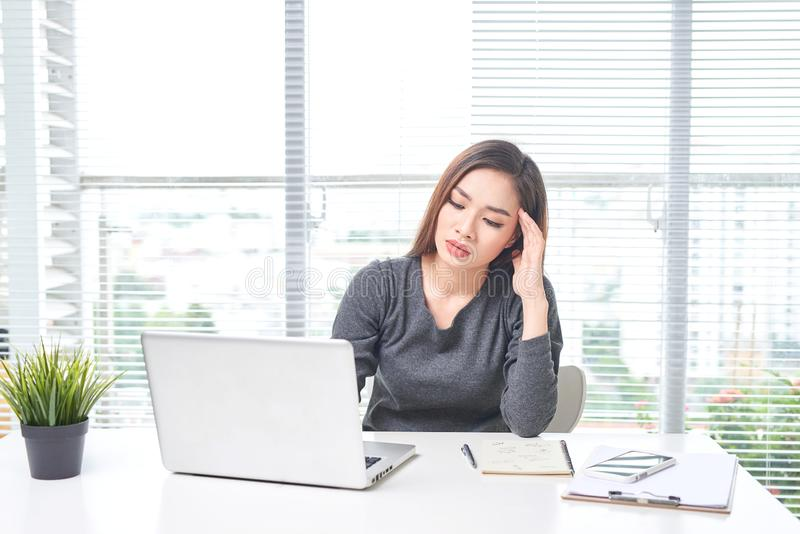 Beautiful young asian business woman working in office using laptop computer stock photos