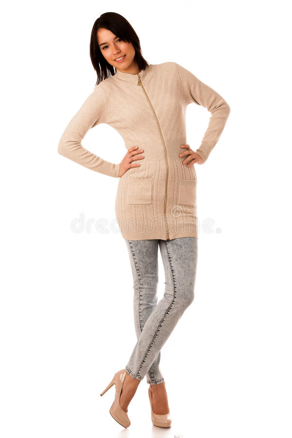 Beautiful young asian caucasian woman in sweater and jeans studio royalty free stock images