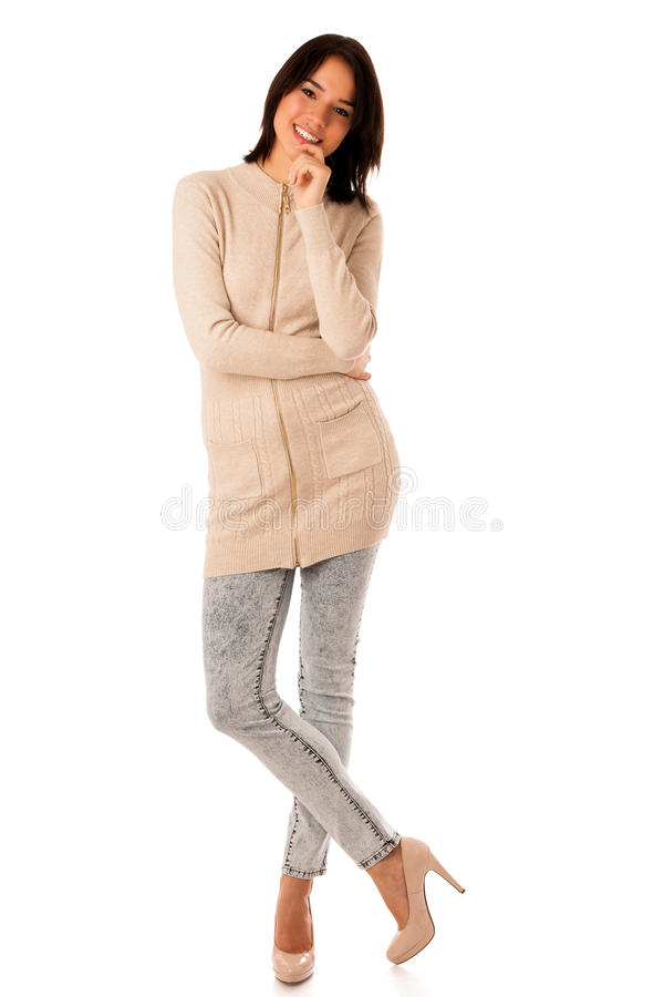 Beautiful young asian caucasian woman in sweater and jeans studio royalty free stock photos