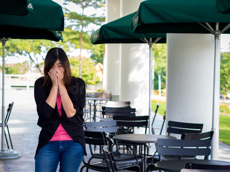 Beautiful Young Asian - Chinese Woman Sneezing / Cough royalty free stock photography