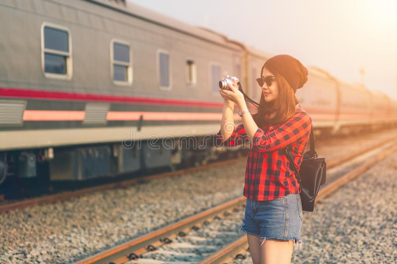 Beautiful young asian girl traveling alone shoot camera enjoying stock images