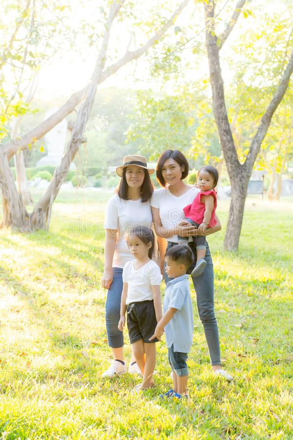 Beautiful young asian parent family portrait picnic in the park stock image