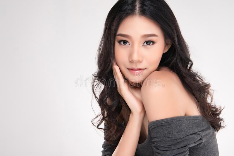 Beautiful Young Asian Woman with Clean Fresh Skin look away, Girl beauty face care. Facial treatment, Cosmetology, beauty and spa stock images