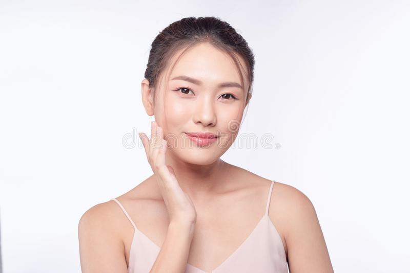 Beautiful Young asian Woman with Clean Fresh Skin look.  stock photo