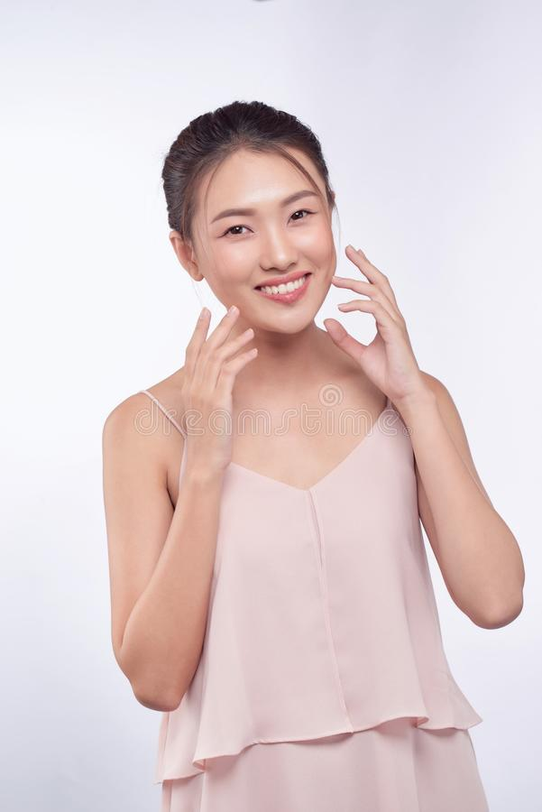 Beautiful Young asian Woman with Clean Fresh Skin look.  stock photos