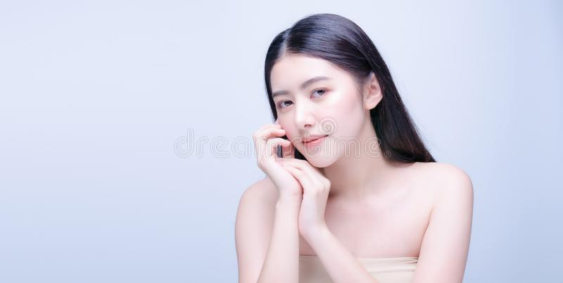 Beautiful Young asian Woman with Clean Fresh Skin look at camera. Girl beauty face care. Facial treatment. Cosmetology, beauty and royalty free stock photo