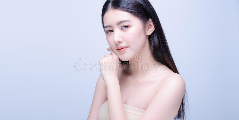 Beautiful Young asian Woman with Clean Fresh Skin look at camera. Girl beauty face care. Facial treatment. Cosmetology, beauty and royalty free stock photos