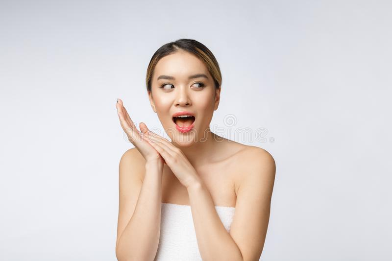Beautiful Young asian Woman with Clean Fresh Skin look. Girl beauty face care. Facial treatment. Cosmetology, beauty and stock photos