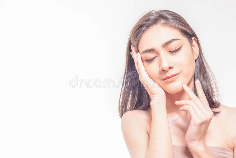 Beautiful young Asian woman with clear fresh skin touch her own face . Facial treatment, skin cleanser, cosmetology, beauty and royalty free stock images