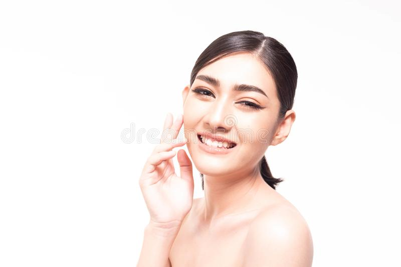 Beautiful young Asian  woman with clear fresh skin touch her own face . Facial treatment, skin cleanser, cosmetology, beauty and stock photos