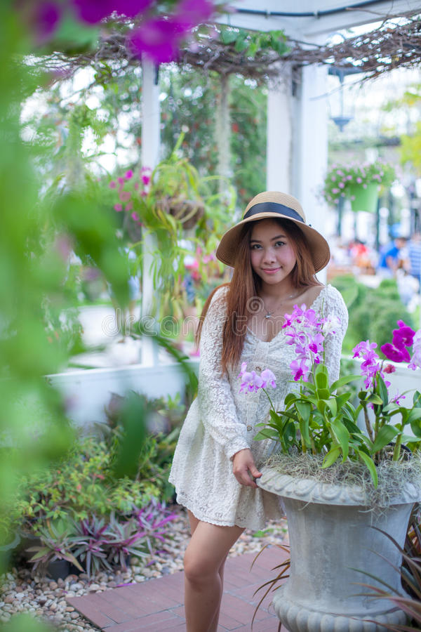 Beautiful young asian woman enjoying. The freshness stock photography