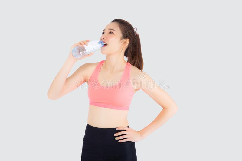 Beautiful young asian woman fit shape drinking water after workout and exercise  on white background. Girl thirsty after aerobic tired for refresh, model royalty free stock image