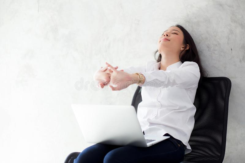 Beautiful young asian woman with laptop stretch and exercise relax after work success. Beautiful young asian woman with laptop stretch and exercise relax after royalty free stock image
