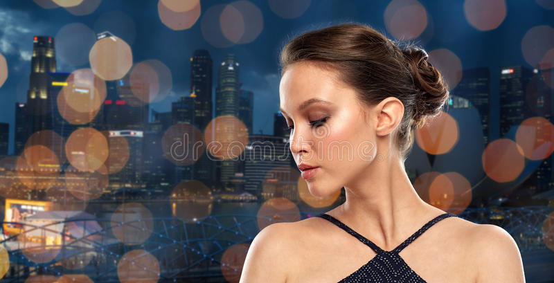 Beautiful young asian woman over black background stock photo