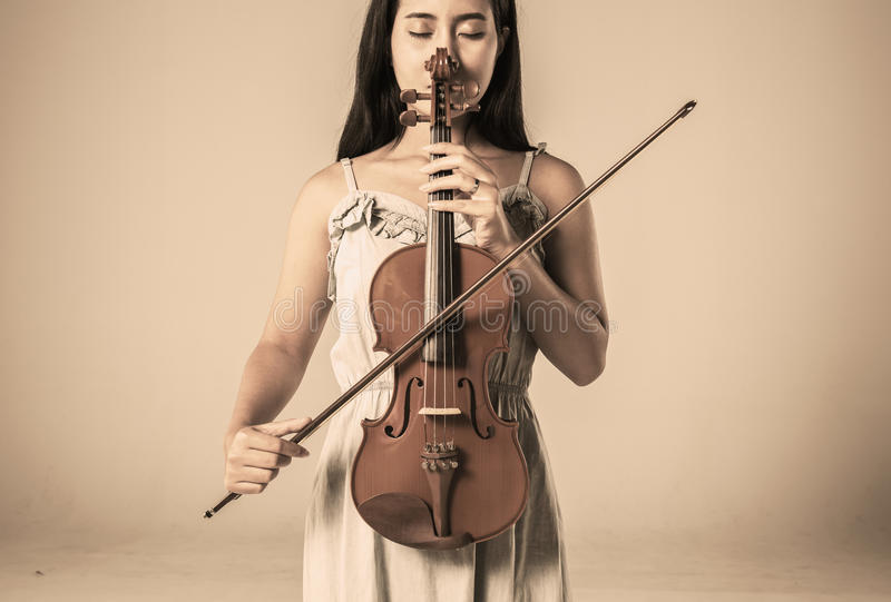 Beautiful young asian woman playing violin stock photography