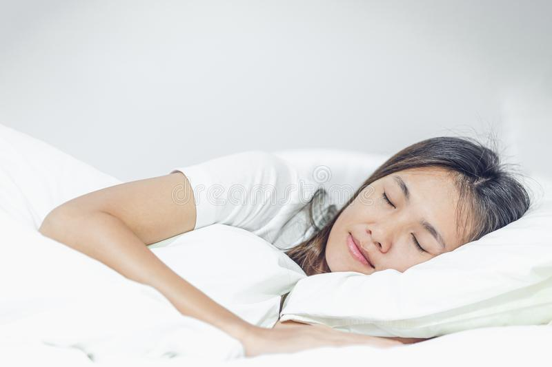 Beautiful young asian woman sleeping in bed stock photo