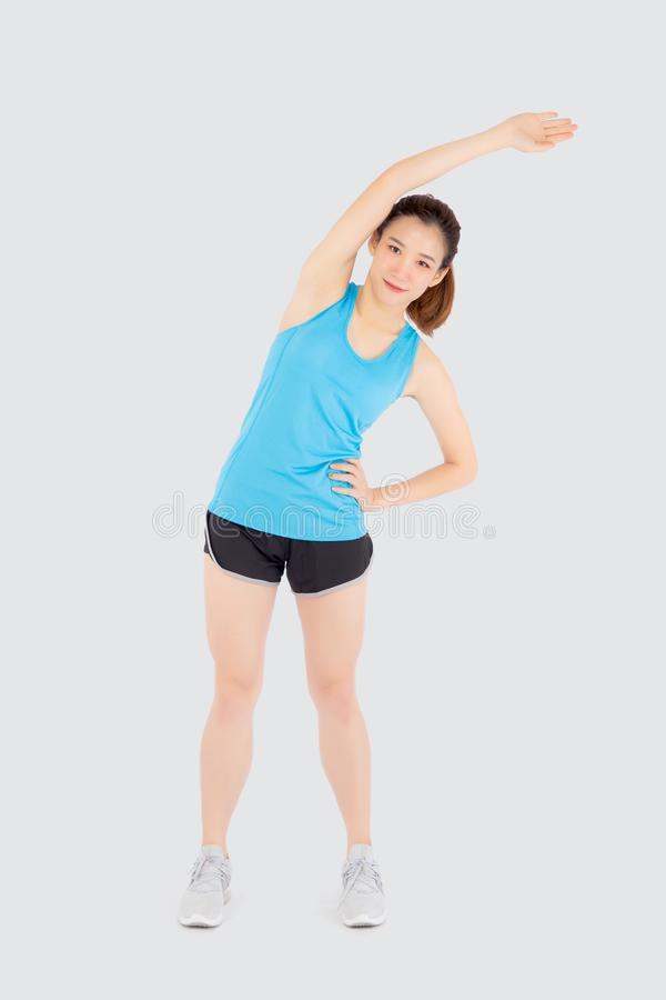 Beautiful young asian woman in sport standing stretch muscle arm workout with healthy isolated on white background. Girl wear shape fit warm up and exercise stock photos