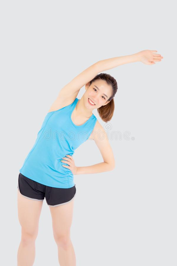 Beautiful young asian woman in sport standing stretch muscle arm workout with healthy isolated on white background. Girl wear shape fit warm up and exercise stock photography