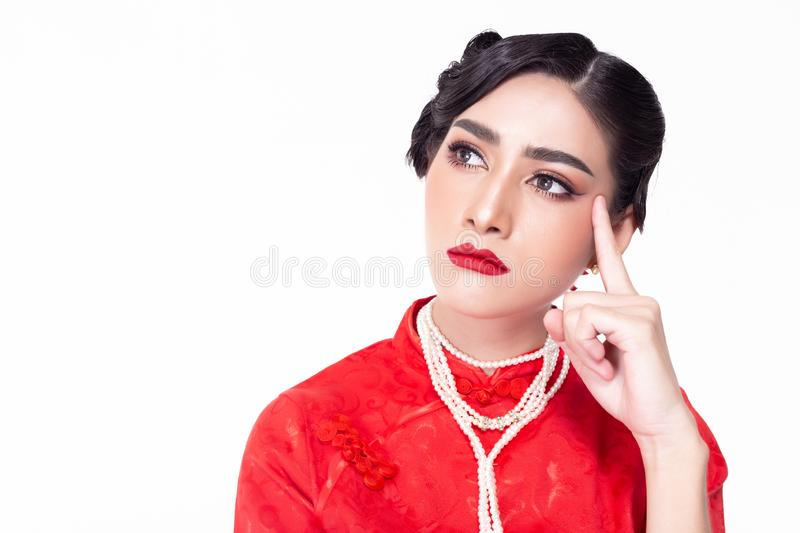 Beautiful young asian woman thinking something. Attractive beautiful girl look at copy space. Charming beautiful lady can't royalty free stock photography