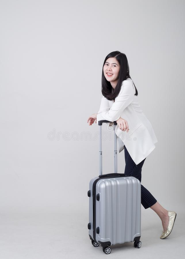 Young Asian woman tourist with luggage to travel royalty free stock photography