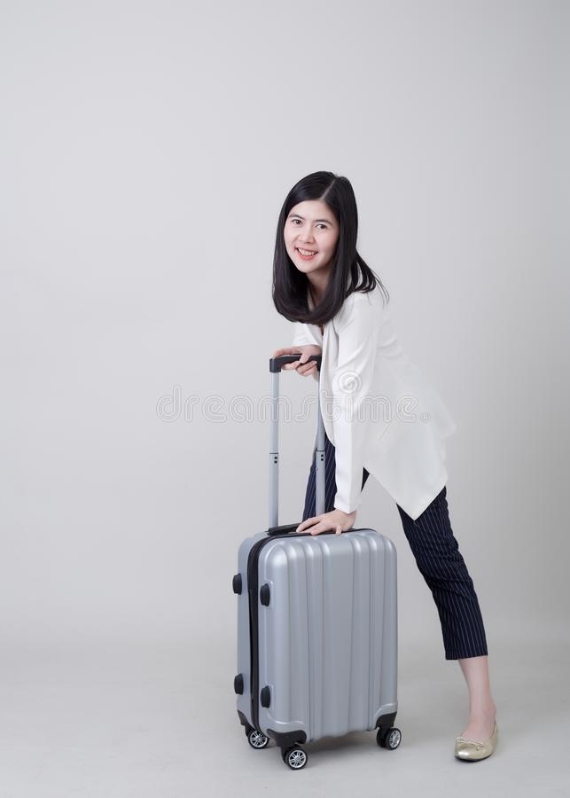 Young Asian woman tourist with luggage to travel royalty free stock photo