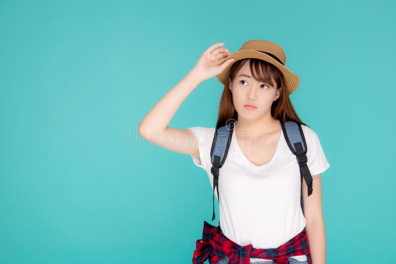 Beautiful young asian woman upset and worry travel summer trip in abroad isolated on blue background royalty free stock image