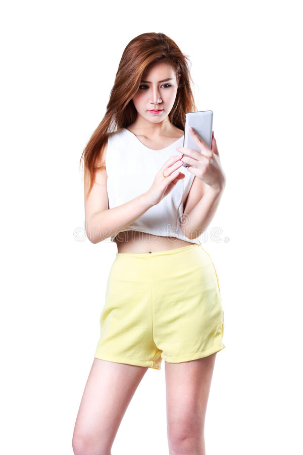 Beautiful young asian woman using smart phone royalty free stock photos