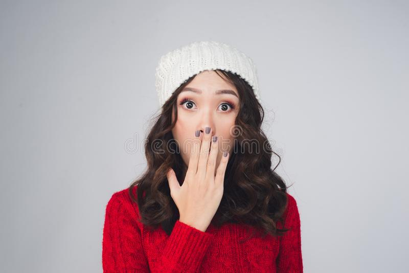 Beautiful young asian woman in warm clothing, surprised stock images