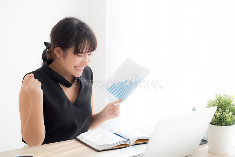 Beautiful young asian woman working laptop computer at office, businesswoman looking graph diagram analysis statistic data stock photography