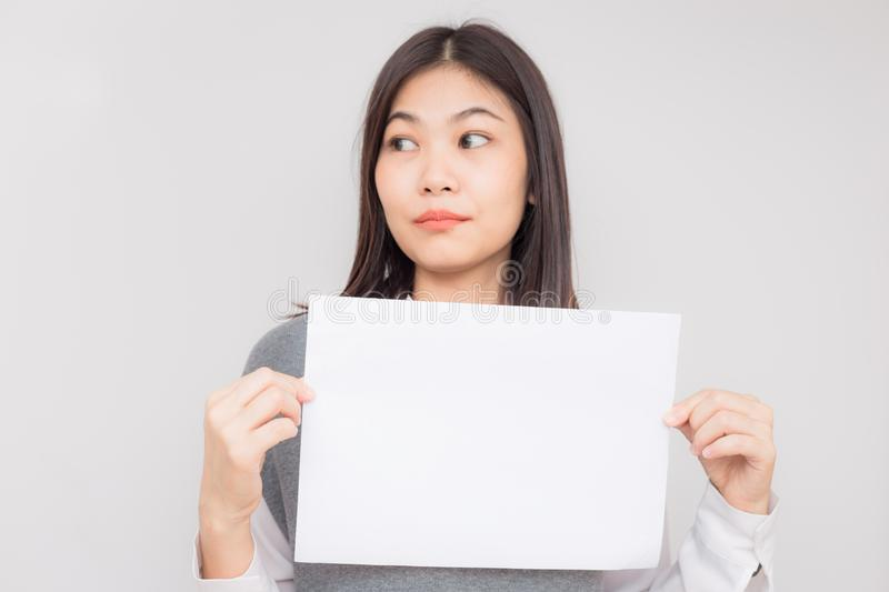 Beautiful young asian women holding blank white paper banner royalty free stock photo