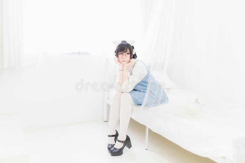 Beautiful young Asian women, Thai people, wearing glasses and casual dressed in Japanese cosplay costumes. royalty free stock photos