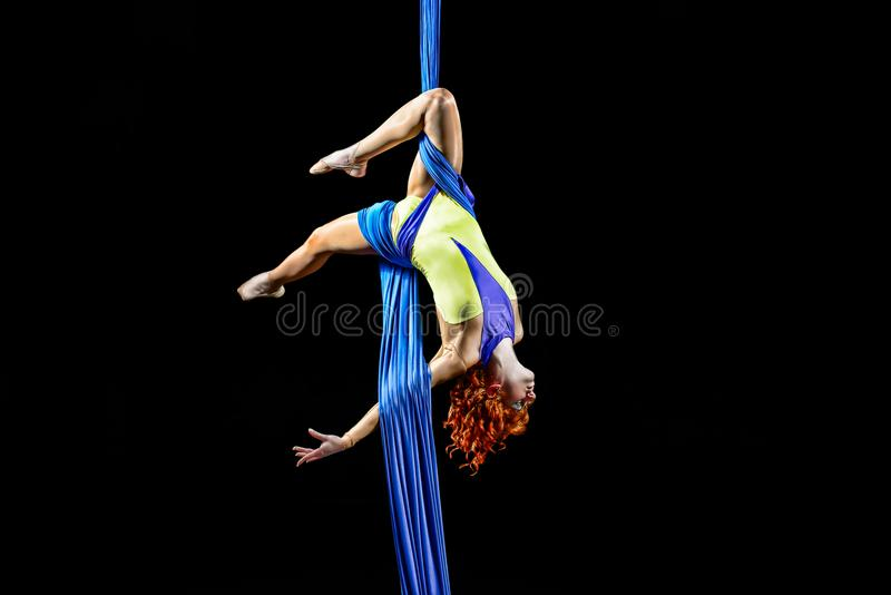 Beautiful young athletic girl dancing in the air with balance. stock photos
