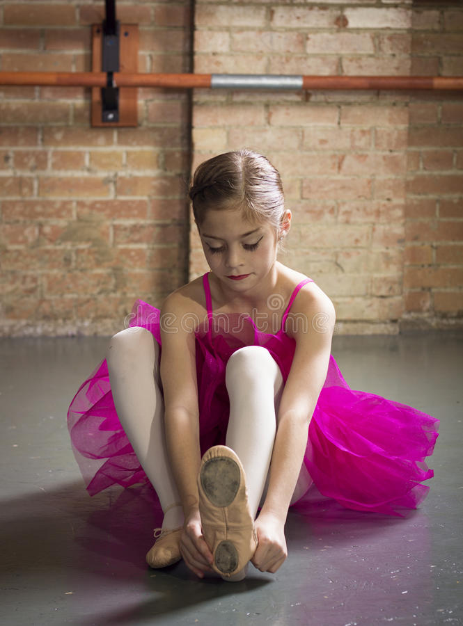 Beautiful young ballerina getting ready for class royalty free stock photography