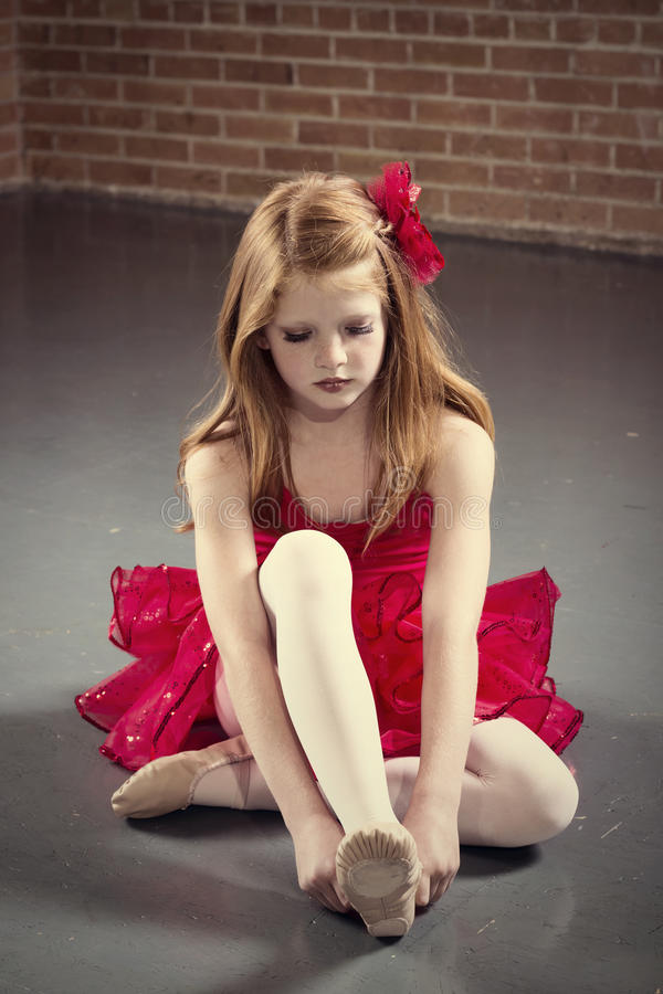 Beautiful young ballerina getting ready for class royalty free stock photos