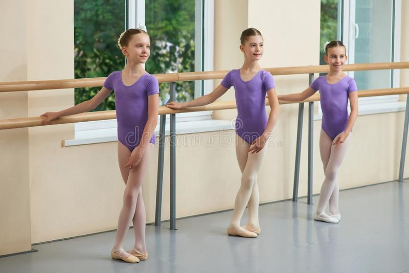 Beautiful young ballerinas with crossed legs. stock photos