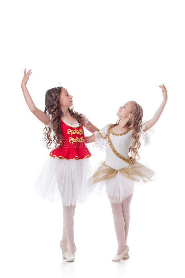 Beautiful young ballerinas dancing in pair royalty free stock images